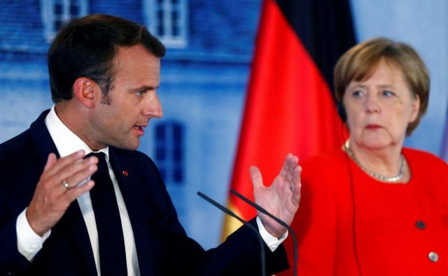 Nemška prvakinja se danes s predsednikom Emmanuelom Macronom srečuje v Marseillu. Foto Reuters