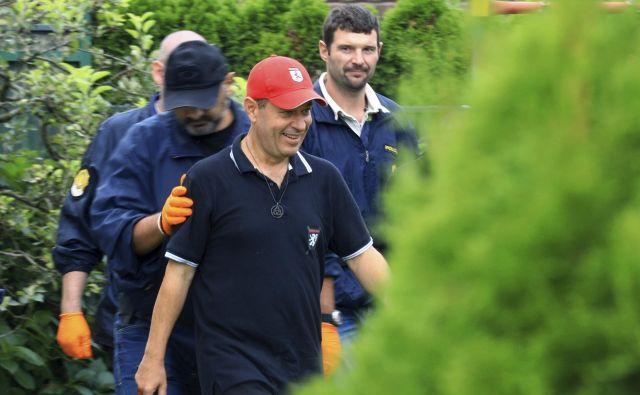 Andrej Šiško se je v rokah policije znašel minuli teden, potem ko so družbena omrežja preplavili posnetki vaje zamaskiranih moških. FOTO: AP