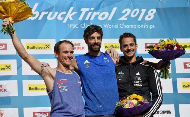 Gregor Selak (desno) se je razveselil že drugega odličja s svetovnih prvenstev. FOTO: Barbara Gindl/AFP