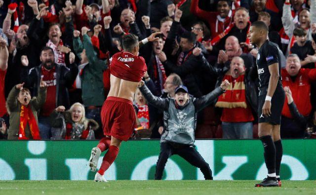 Roberto Firmino je izničil izenačujoči zadetek Kyliana Mbappeja (desno) in Liverpoolu prinesel prestižno zmago. FOTO: Reuters