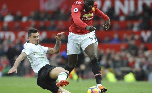 Dejan Lovren se trenutno ne ubada le s poškodbo, zaradi katere ga ni v kadru Liverpoola. FOTO: AP