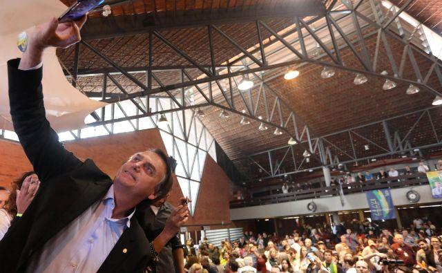 Sodeč po anketah javnega mnenja bo Bolsonaro na oktobrskih volitvah zbral največ glasov. FOTO: Reuters