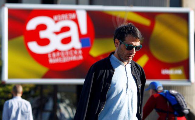 Makedonci bodo jutri na posvetovalnem referendumu odločali o sporazumu z Grčijo, ki med drugim predvideva preimenovanje države v Republiko Severno Makedonijo.FOTO: Ognen Teofilovski/Reuters