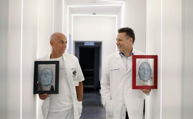 Kirurga Uroš Ahčan in Vojko Didanovič FOTO: Matej Družnik