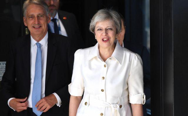 Vlada Therese May bo z omejevanjem priseljevanja lahko dokazovala svojo odločnost pri uresničevanju referendumske odločitve. FOTO: Paul ELLIS / AFP