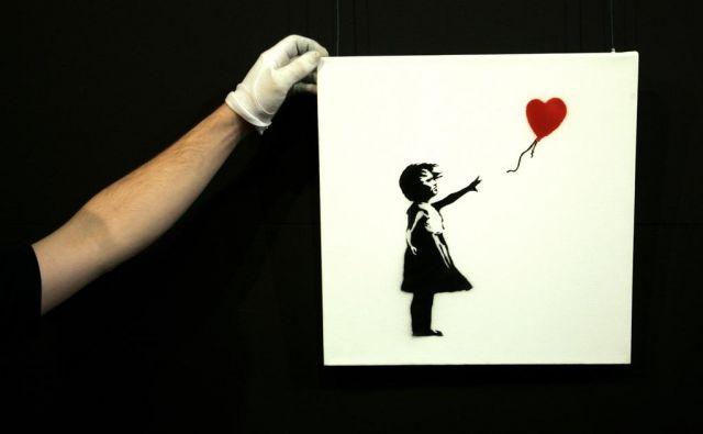 Deklica z balonom je eno najbolj znanih Banksyjevih del. FOTO:Reuters