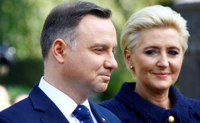 Poljski predsednik Andrzej Duda in žena Agata Kornhauser-Duda. FOTO: Arnd Wiegmann/Reuters