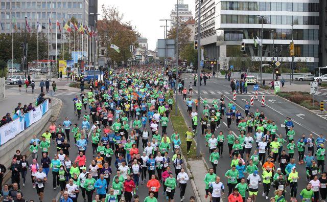 Prihodnjo nedeljo bo ljubljanske ulice znova preplavila množica tekačev. FOTO: Jože Suhadolnik/Delo