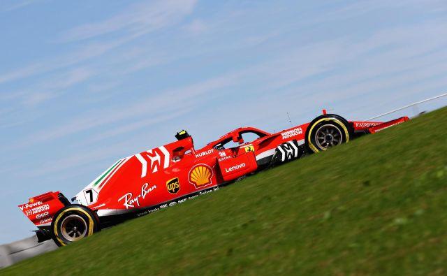 Kimi Räikkönen je zmagal prvič po uvodu v sezono 2013. FOTO: Mark Thompson/AFP
