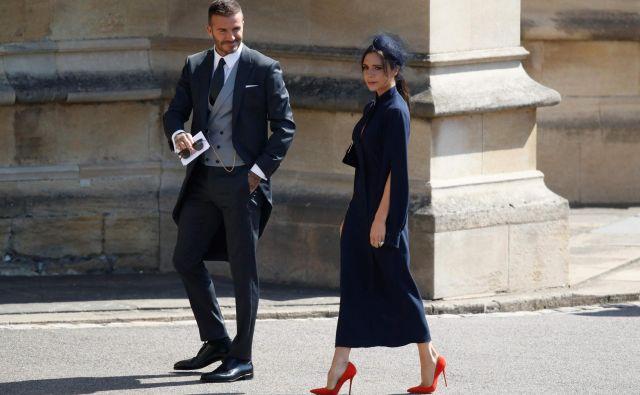 David in Victoria Beckham na poroki princa Harryja in Meghan Markle FOTO: AFP