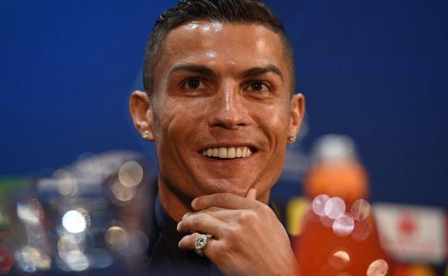 Cristiano Ronaldo je na novinarski konferenci večkrat poudaril, da je srečen človek. FOTO: AFP