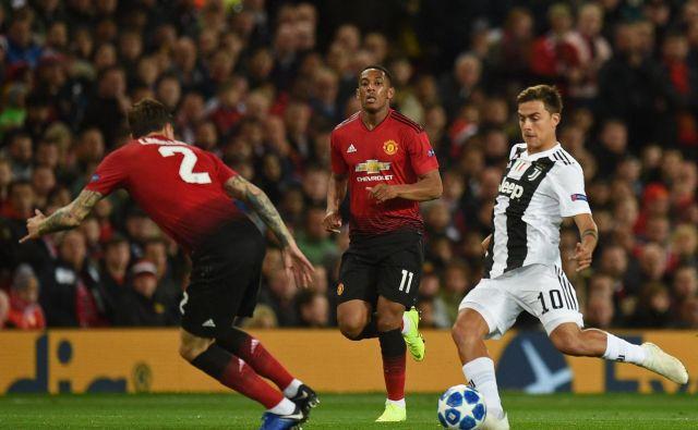 Paulo Dybala je odločil dvoboj velikanov na Old Traffordu, na katerem je bili veliki le Juventus. FOTO: AFP
