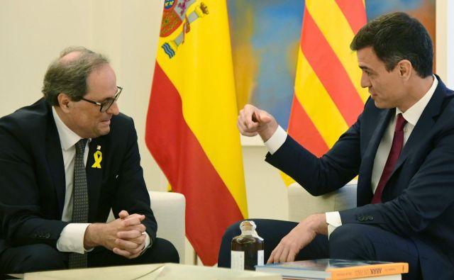 Quim Torra (levo) in Pedro Sanchez julija v Madridu FOTO: AFP