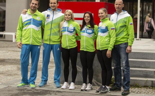 Gimnastična reprezentanca pred odhodom na SP. Na fotografiji: Sašo Bertoncelj, Teja Belak, Tjaša Kysselef, Lucija Hribar. FOTO: Voranc Vogel/Delo