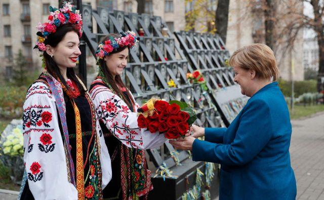 Argumenti kanclerke Merkel v zadnjem času najdejo nekaj več odmevov tudi v Beli hiši predsednika Donalda Trumpa. Foto: AFP