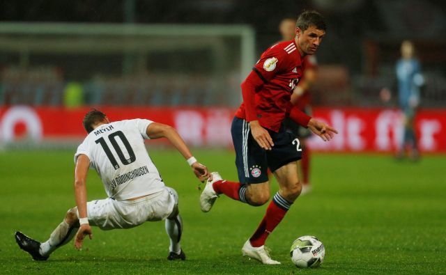 Thomas Müller je uspešno izvedel enajstmetrovko. FOTO: Leon Kügeler/Reuters