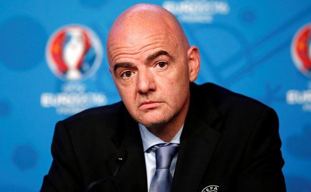 FIFA ščiti svojega predsednika Giannija Infantina. FOTO: Benoit Tessier/Reuters