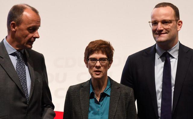 Friedrich Merz (levo), Annegret Kramp-Karrenbauer (na sredini) in Jens Spahn kandidirajo za naslednjico Angele Merkel. FOTO: Reuters
