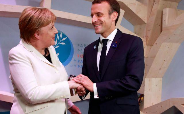 Angela Merkel in Emmanuel Macron sta pozvala k miru. FOTO: Gonzalo Fuentes/Afp