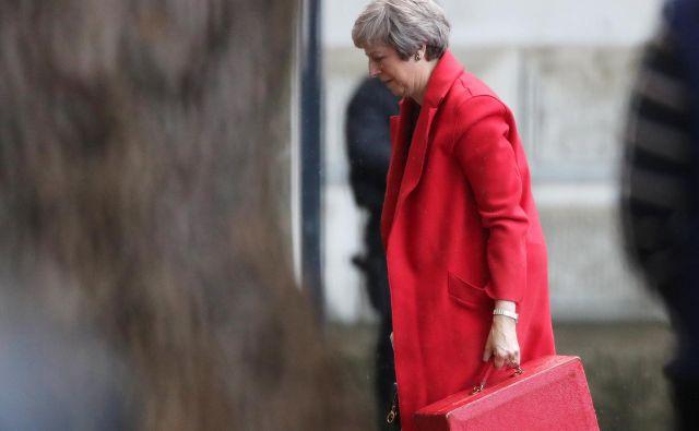 Britanska ministrska predsednica Theresa May je na svoj kontroverzni predlog dogovora z EU stavila ves svoj politični kapital. FOTO: Reuters