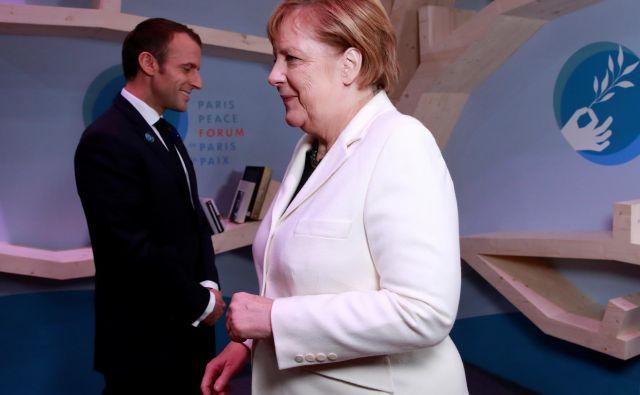 Nemška kanclerka Angela Merkel in francoski predsednik Emmanuel Macron. Foto: Gonzalo Fuentes/Reuters