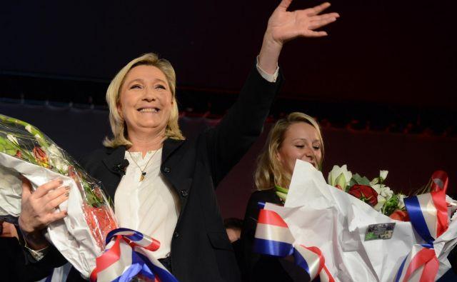 Francozinji skrajno desne ideologije Marine Le Pen (levo) in Marion Maréchal-Le Pen. Foto Reuters