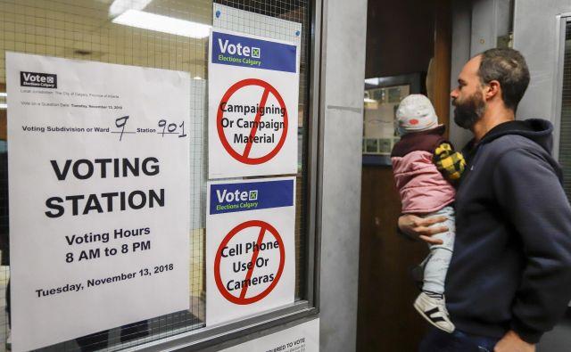 Prebivalci Calgaryja so večinsko proti gostiteljstvu olimpijskih iger. FOTO: Jeff McIntosh/AP