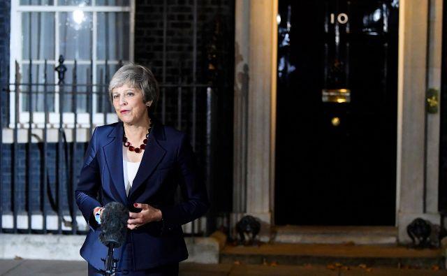 Izjava britanske premierke Therese May po potrditvi osnutka ločitvenega dogovora z EU. FOTO: REUTERS/Toby Melville