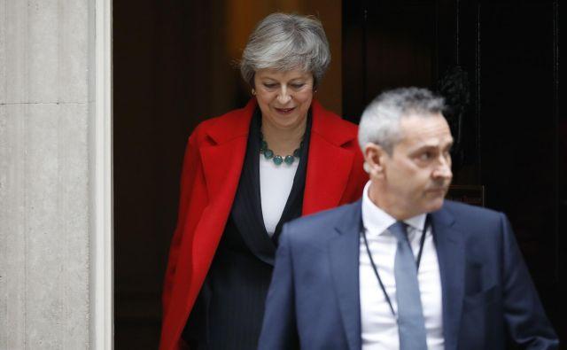 Britanska premierka Theresa May z največjim preizkusom svoje podpore doslej. FOTO: Tolga AKMEN / AFP