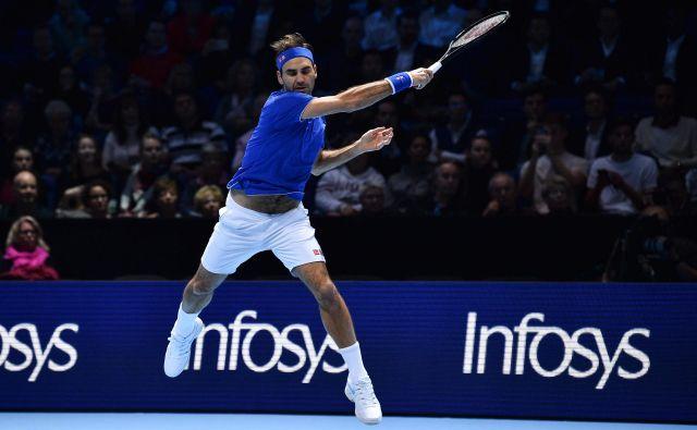 Roger Federer je slabo začel masters v Londonu, a predtekmovalni del končal zmagovito, osvojil je 1. mesto v skupini. FOTO: AFP