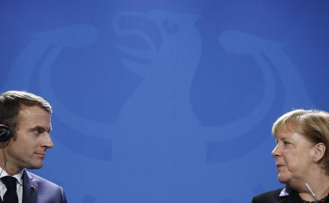 Macron je na srečanju z Merklovo optimistično razmišljal o vlogi stare celine. FOTO: AFP