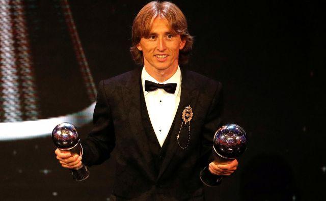 Če ne bi bilo afere povezane z izmikanjem davkom, bi bil Luka Modrić človek in nogometaš z veliko začetnico. FOTO: Reuters