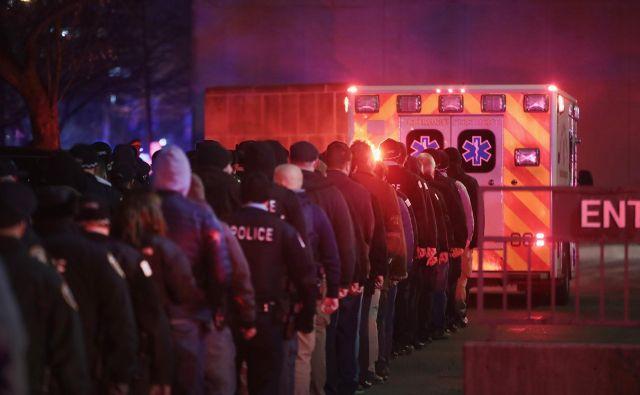 Umrle so štiri osebe. FOTO: Scott Olson/AFP