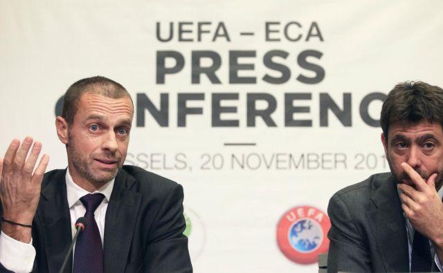 Predsednik Uefe Aleksander Čeferin in prvi mož klubskega združenja Eca, tudi predsednik Juventusa, Andrea Agnelli v Bruslju. FOTO: Reuters