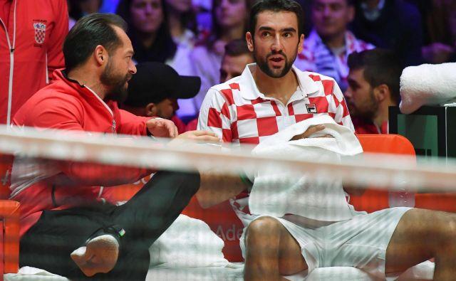 Željko Krajan v pogovoru s prvim loparjem Marinom Čilićem. FOTO: Philippe Huguen/AFP
