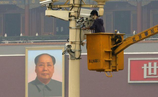 Kitajski družbeni kreditni sistem bo temeljil na internetu, nadzornih kamerah in drugih »očeh« velikega brata. FOTO: Reuters