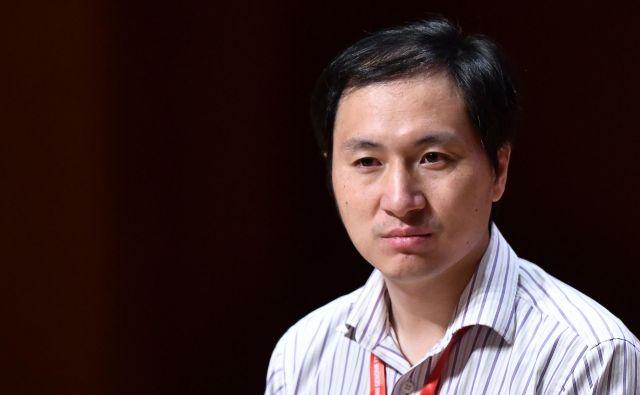Nastop He Jiankuija je bil tažko pričakovan zaradi sporne raziskave. FOTO: Anthony Wallace/AFP