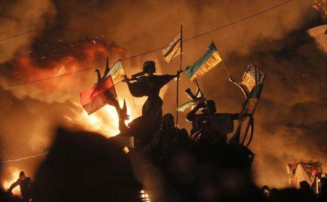 Ukrajina ni članica Nata in verjetno tudi ne bo. Vzrok ni samo neposredna bližina Rusije in tveganje provokacij, ampak tudi razdeljenost samega naroda. FOTO: Efrem Lukatsky/AP