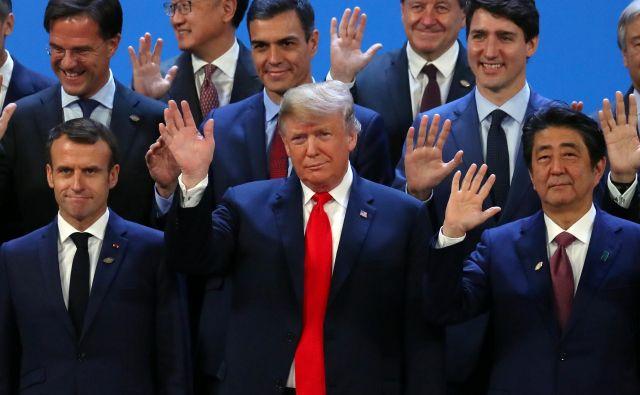 Voditelji držav G20 so na vrhu v Buenost Airesu sprejeli skupno izjavo, v kateri so, sicer brez ZDA, podprli zavezanost k uresničevanju pariškega podnebnega sporazuma. FOTO: Marcos Brindicci/Reuters