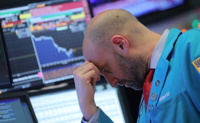 Borzni krč je napenjal predvsem strah, da se bo trgovinski spopad ZDA in Kitajske nadaljeval, kar bi prizadelo ameriško gospodarsko rast, hkrati pa še poglobilo sedanje težave v Evropi in Aziji. Foto Brendan Mcdermid/Reuters