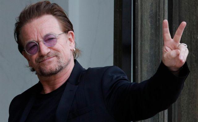 Bonu in zasedbi U2 je po ocenah Forbesa prvo mesto med zaslužkarji v glasbeni industriji prinesel izkupiček s koncertov. FOTO: Philippe Wojazer/Reuters