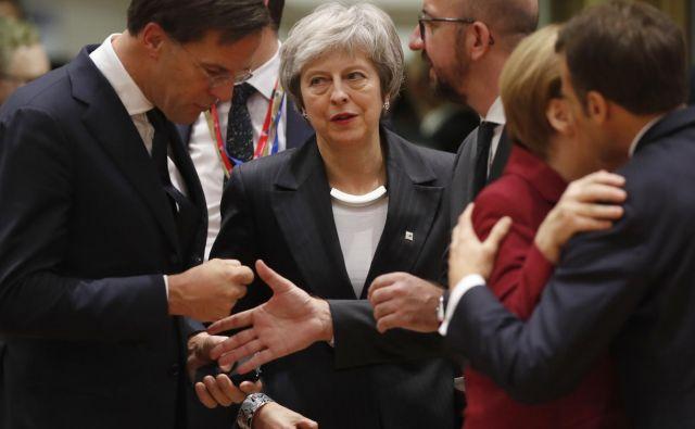Britanska premierka Theresa May utegne postati tragična figura razprav o brexitu. FOTO: Alastair Grant/AP