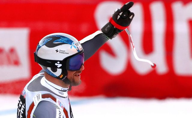 Aksel Lund Svindal je z dvignjeno roko pospremil svojo peto zmago v Val Gardeni, tretjo v superveleslalomu. FOTO: Alessandro Garofalo/Reuters