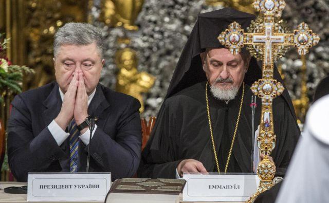 Novoustanovljena ukrajinska cerkev je državotvorni religiozni projekt ukrajinskega predsednika Petra Porošenka. Foto: AP
