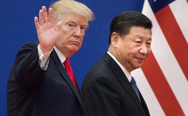 Donald Trump in Xi Jinping sta poskrbela za kratkotrajno prekinitev trgovinske vojne, ki se bo še bolj silovito nadaljevala v letu 2019. FOTO: AFP