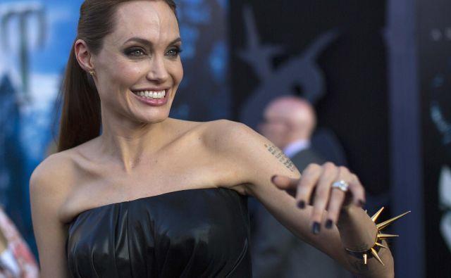 Angelina Jolie ni le slavna igralka, ampak tudi mati z običajnimi starševskimi skrbmi. FOTO Reuters