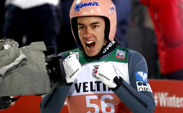 Stefan Kraft je za zmago na prvih kvalifikacijah prejel 5000 evrov. FOTO: AP