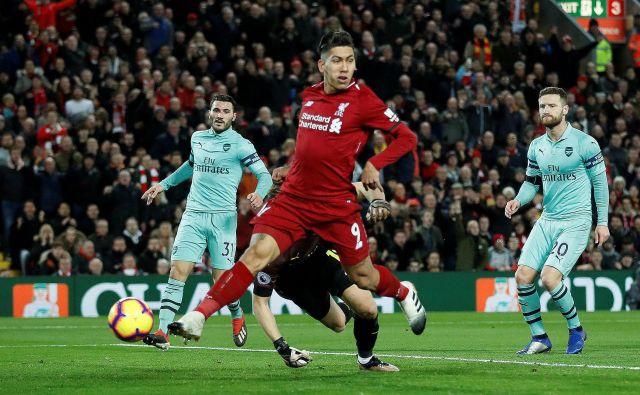 Roberto Firmino je dosegel prvi trojček golov v Liverpoolovi majici. FOTO: Carl Recine/Reuters