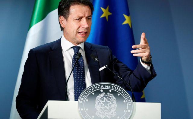 Predsednik vlade je zagotovil, da bodo Italijaninemudoma občutili pozitivne učinke proračuna. FOTO: Francois Lenoir/Reuters