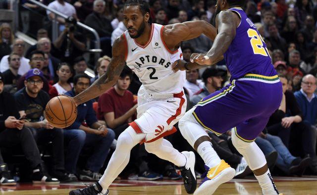 Kawhi Leonard je imel enega svojih večerov, zaradi katerih si ga v svojih vrstah želi vsako moštvo v ligi NBA. FOTO: Reuters